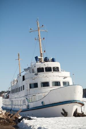 motor launch: Moored small white passenger ship on the coast of Saimaa lake, Finland Stock Photo