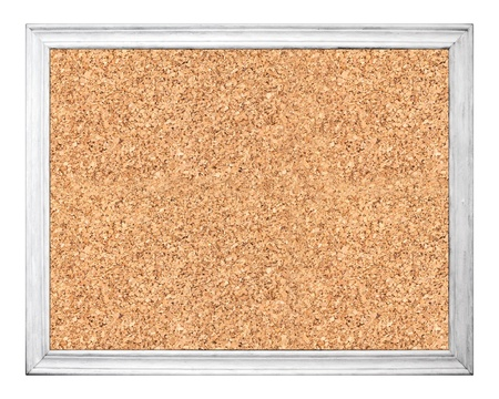 Empty cork board in white wooden frame isolated on white photo