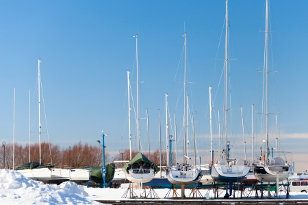 Luxury yachts on the coast in winter season  Tallinn, Estonia photo