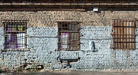 Old abandoned building wall texture with locked windows photo