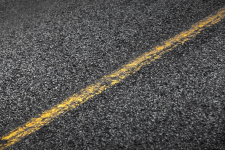 solid line: Asphalt road with yellow solid line  Transportation background texture Stock Photo