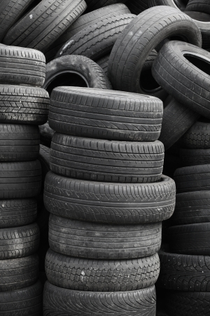 Old used stacked tires  Vertical background texture Stock Photo - 19761127