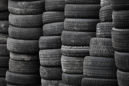 Old used stacked tires background photo