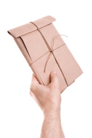 Man s hand holds envelope Stock Photo