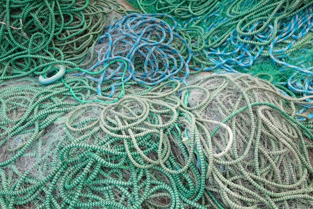 Background texture of fishing net drying on the sea coast in Norway photo