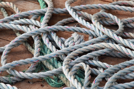 Nautical rope lies on the ships deck photo