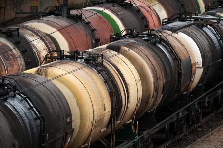 Railroad scene with trains of oil tanks photo