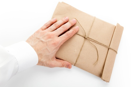printed matter: Male hand and envelope tied with a rope on white background