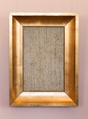 Old classical wooden frame with blank canvas on hanging the wall photo