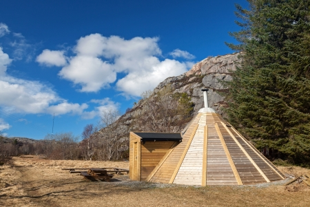 Small wooden free for use camping house in Norwegian park photo