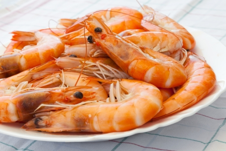 Pile of prepared shrimps on the plate photo