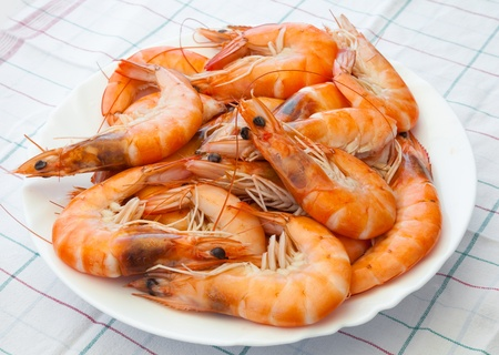 Pile of prepared shrimps lays on the plate photo
