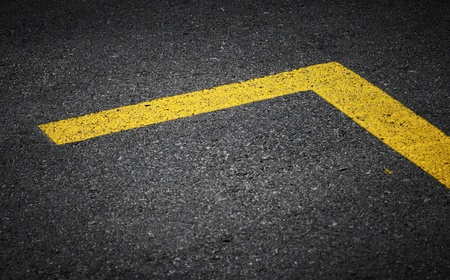 marking up: Road marking with yellow lines on dark asphalt