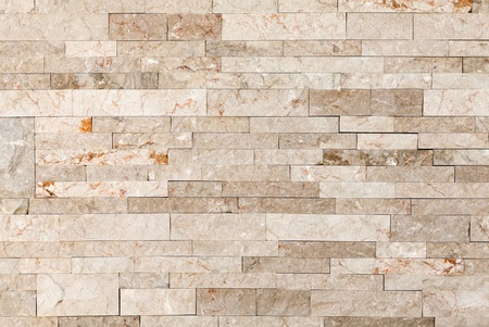 Architectural background texture. Wall made of marble blocks photo