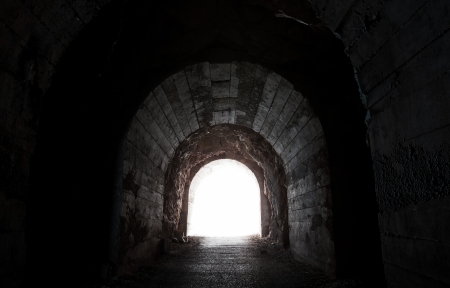 tunnel portals: Glowing end of dark abandoned tunnel Stock Photo