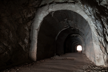 darkness: Dark abandoned tunnel interior perspective with glowing end