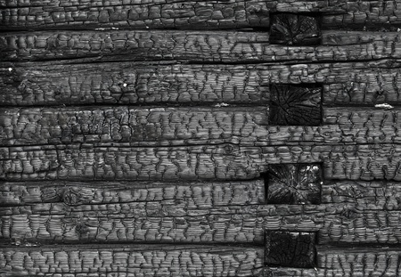 Burned black wooden wall background texture photo