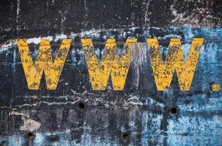 Dark blue concrete wall with yellow www label. Photo background texture photo