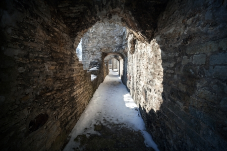 Old stone fortress dark stone tunnel perspective photo