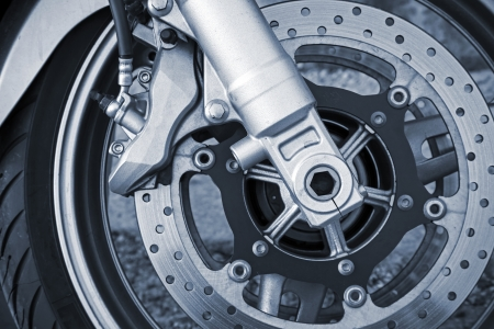Motorcycle wheel with brake. Closeup monochrome photo photo