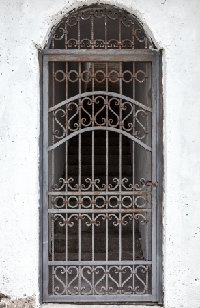 closed wrought iron railing on doorway with stairs photo