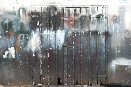 Background texture with closed grunge wooden gate photo