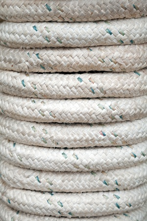 Bundle of gray marine rope closeup background texture photo