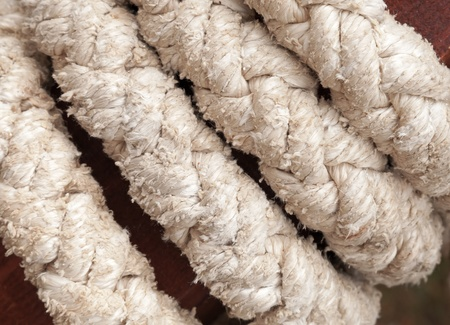 Thick rough gray marine rope macro photo photo