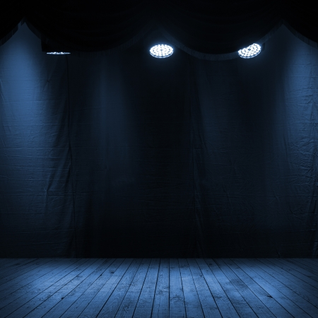 Dark blue scene interior with spotlights, wooden stage and fabric background