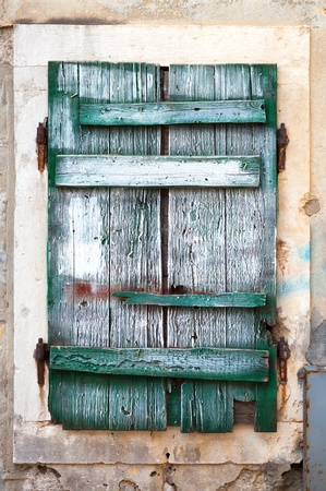 Old green wooden window blinds. Photo background texture photo