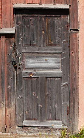 Old brown locked wooden door background texture photo