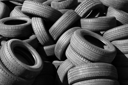 Pile of old used automotive tires photo