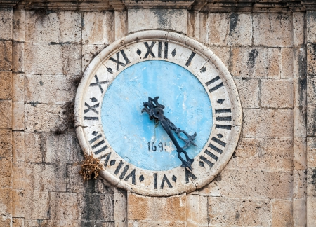 Ancient clock tower of central Saint Nicholas Church, Perast town, Montenegro photo