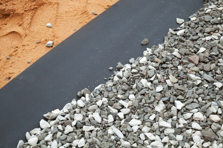 textille: Geotextile layer between gravel and sandy ground