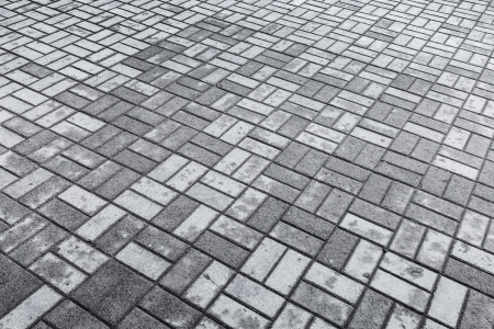 Background texture of gray modern cobblestone road with wet and dry stones pattern photo