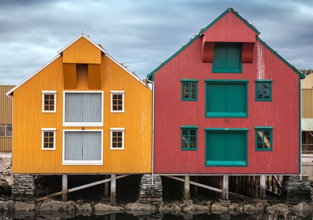 stilts: Red and yellow coastal wooden houses in Norway
