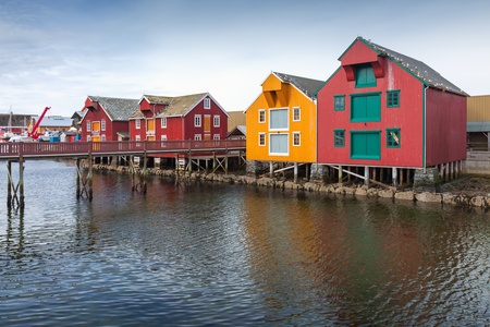 Red and yellow wooden houses in coastal Norwegian fishing village  Rorvik, Norway photo
