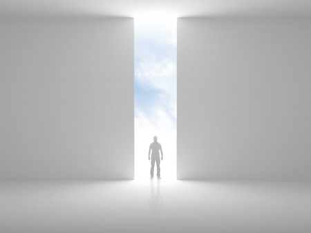 looking out: Abstract empty interior with opening in the wall and a man standing in the light