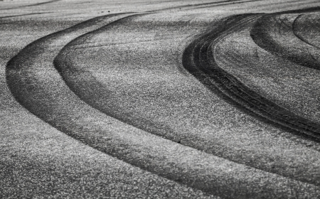 squeal: Abstract background with curved tires tracks on dark asphalt road Stock Photo