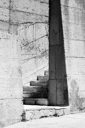 Abstract industrial architecture fragment with gray concrete walls and stairs photo