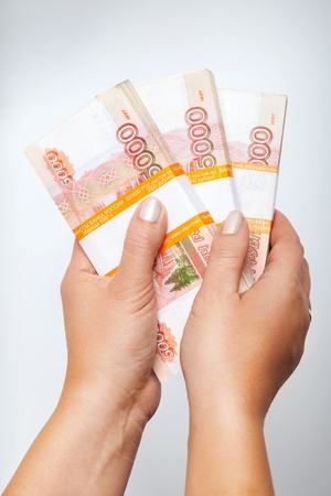 http://us.123rf.com/450wm/eugenesergeev/eugenesergeev1309/eugenesergeev130900118/22133780-stacks-of-money-russian-rubles-banknotes-in-female-hands-above-gray-background.jpg