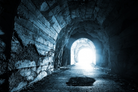 tunnel portals: Glowing exit from dark abandoned tunnel  Monochrome blue photo