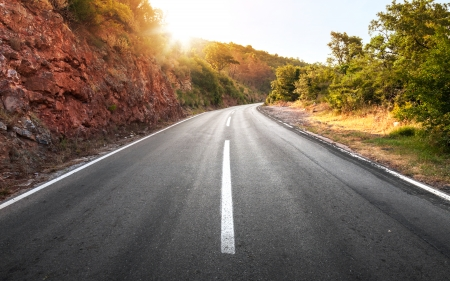 Empty rural asphalt highway perspective with bright shining sun photo
