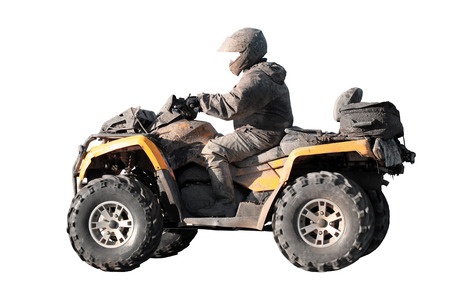 Dirty off-road yellow ATV with rider isolated on white background photo
