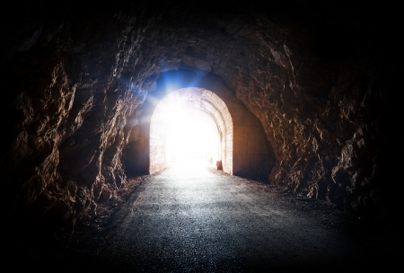 hope concept: End of dark tunnel with magic blue light from the outside Stock Photo