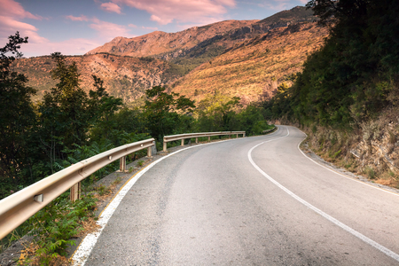 Montenegro, curved  mountain highway in soft early morning sun light photo