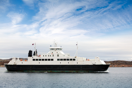 ferryboat: White passenger ferry goes on fjord in Norway Stock Photo