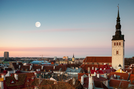 St. Nicholas Church and moon in old town of Tallinn, Estonia photo