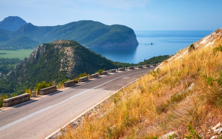 Summer mountain road with blue sky and sea o. Adriatic sea coast, Montenegro photo