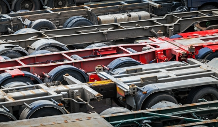 Automotive transportation abstract background with empty trucks cargo trailers photo